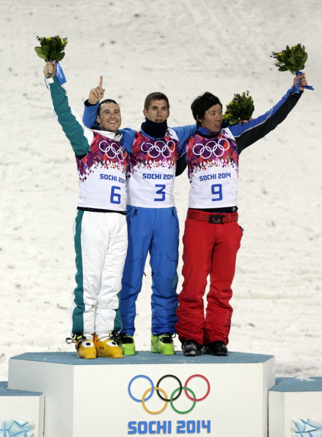 David Morris (AUS) (left) and Anton Kushnir (BLR) (middle) and Zongyang Jia (CHN) (right) at the flower ceremony. (Andrew P. Scott, USA TODAY Sports)