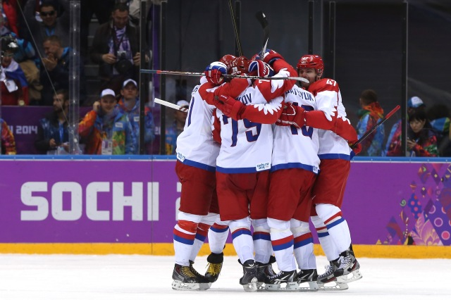 Pavel Datsyuk of Russia celebrates with teammates after scoring a third-period goal against the United States. (Bruce Bennett/Getty Images)
