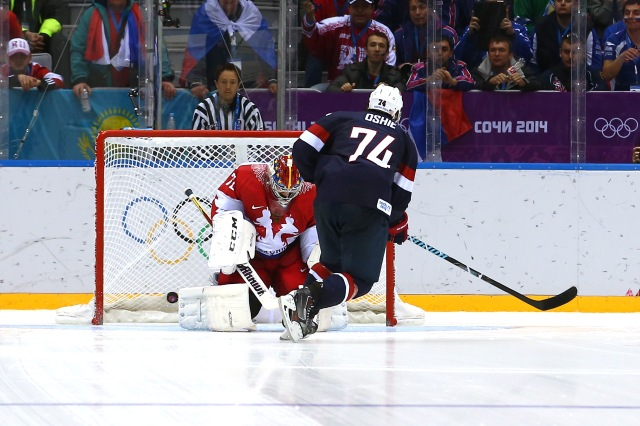 T.J. Oshie scores on a shootout against Sergei Bobrovski. (Streeter Lecka/Getty Images)