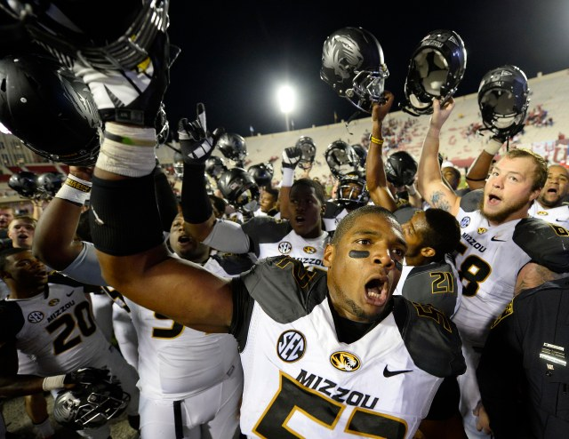 Michael Sam (52) celebrates beating Indiana last season. He'll be the first openly gay player entered in the draft. (Mike DiNovo-USA TODAY Sports)