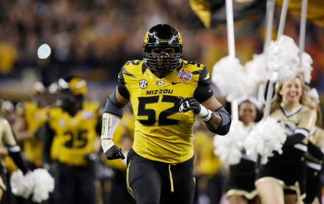 Missouri Tigers defensive lineman Michael Sam (52) runs on the field before the game against the Oklahoma State Cowboys at the 2014 Cotton Bowl at AT&T Stadium. Missouri beat Oklahoma State 41-31. (Tim Heitman, USA TODAY Sports)