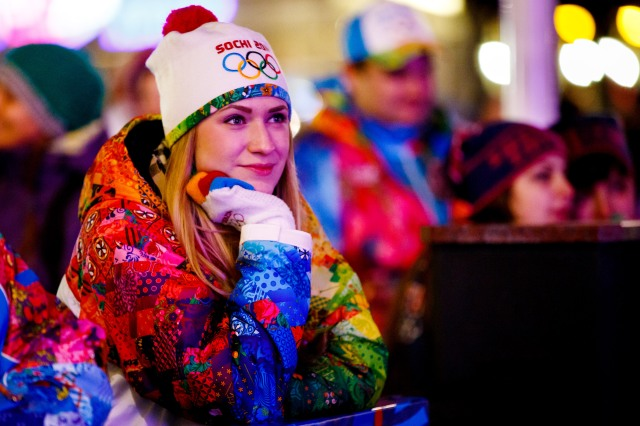 Julya Glubokaya of Russia watches opening ceremonies for the Sochi 2014 Winter Olympic Games on a video screen at a live site in the mountain cluster. (Guy Rhodes, USA TODAY Sports)