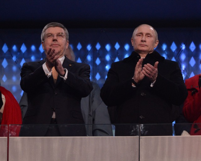 International Olympic Committee president Thomas Bach (left) and Russian president Vladimir Putin (right) wave to the crowd during the opening ceremony for the Sochi 2014 Olympic Winter Games at Fisht Olympic Stadium. (Robert Deutsch, USA TODAY Sports)