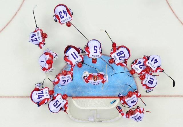 Russia players huddle around goalkeeper Sergei Bobrovski before the game. (Scott Rovak, USA TODAY Sports)
