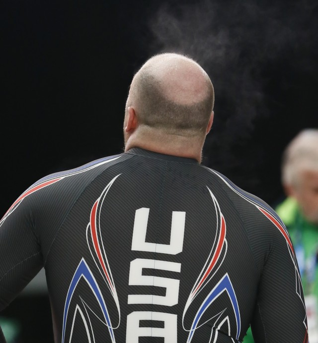 team rises off the head of USA-1 pilot Steven Holcomb after heat 1 of two-man bobsled. Rob Schumacher, USA TODAY Sports)