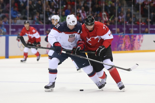 U.S. defenseman Ryan Suter takes a penalty against Canada's Jeff Carter. (Winslow Townson, USA TODAY Sports)