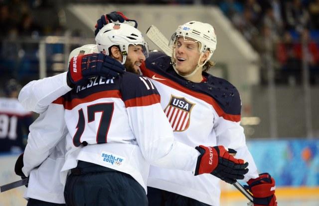USA forward Ryan Kesler (17) celebrates with defenseman John Carlson (4) after scoring a goal against Slovakia. (ayne Kamin-Oncea, USA TODAY Sports)