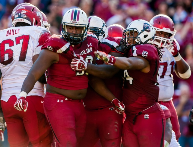 South Carolina Gamecocks defensive tackle Kelcy Quarles and linebacker Shaq Wilson celebrate a play against the Arkansas Razorbacks . (Jeff Blake - USA TODAY Sports)