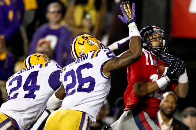 Ole Miss Rebels wide receiver Donte Moncrief catches a touchdown over LSU Tigers safety Ronald Martin and cornerback Tharold Simon at Tiger Stadium. (Derick E. Hingle - USA TODAY Sports)