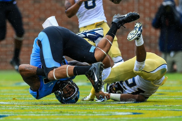North Carolina Tar Heels tight end Eric Ebron lands in the end zone for a touchdown with coverage by Georgia Tech Yellow Jackets defensive back Demond Smith at Bobby Dodd Stadium. (Daniel Shirey-USA TODAY Sports)