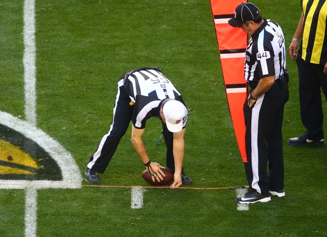 NFL referee Walt Anderson spots the ball after measuring with the chains during the game between the San Francisco 49ers and Arizona Cardinals. (Mark J. Rebilas-USA TODAY Sports)