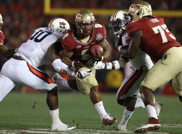 Florida State Seminoles tailback Devonta Freeman runs with the ball against Auburn Tigers during the 2014 BCS National Championship game at the Rose Bowl. (Matthew Emmons - USA TODAY Sports)
