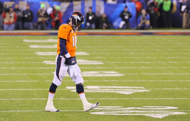 Peyton Manning meanders sadly off the field after a brutal first half.  (Adam Hunger-USA TODAY Sports)