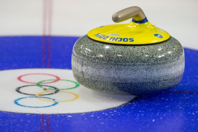 A stone sits on the ice during women's curling practice at Ice Cube Curling Center. (Kevin Liles, USA TODAY Sports)