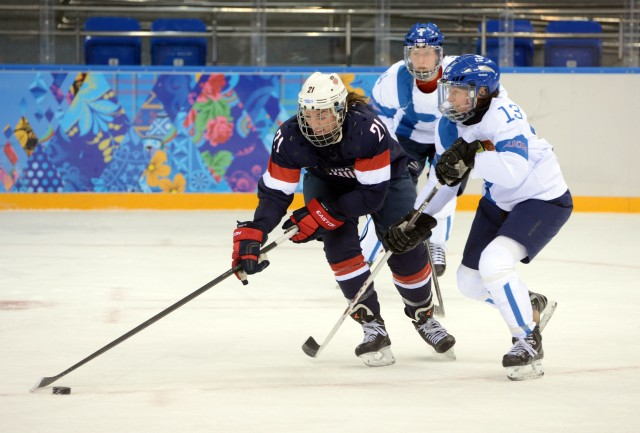 USA forward Hilary Knight (21) carries the puck past Finland forward Rikka Valila (13) during the women's ice hockey preliminary round game in the Sochi 2014 Olympic Winter Games at Shayba Arena. Mandatory Credit: Winslow Townson-USA TODAY Sports