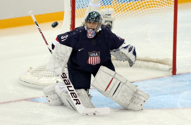 USA goalkeeper Jessie Vetter (31) makes a save against Finland during theomen's ice hockey preliminary round game in the Sochi 2014 Olympic Winter Games at Shayba Arena. (Credit: Winslow Townson - USA TODAY Sports)