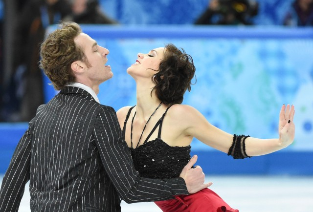 Nathallie Pechalat and Fabian Bourzat of France perform in the team ice dance short dance program during the Sochi 2014 Olympic Winter Games at Iceberg Skating Palace. Mandatory Credit: Robert Deutsch-USA TODAY Sports