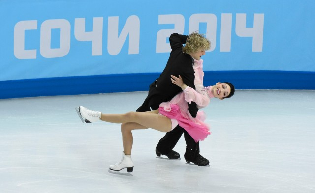 Meryl Davis and Charlie White of the USA perform in the team ice dance short dance program during the Sochi 2014 Olympic Winter Games at Iceberg Skating Palace. Mandatory Credit: Richard Mackson-USA TODAY Sports