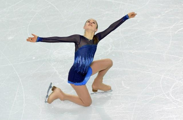 Yulia Lipnitskaya (RUS) performs during the team ladies short program during the Sochi 2014 Olympic Winter Games at Iceberg Skating Palace. Mandatory Credit: Richard Mackson-USA TODAY Sports