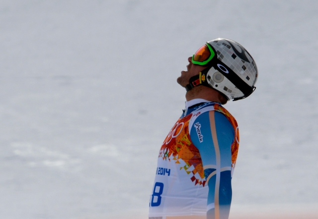 Askel Lund Svindal (NOR) reacts after his run in the men's downhill during the Sochi 2014 Olympic Winter Games at Rosa Khutor Alpine Center. Mandatory Credit: Paul Bussi-USA TODAY Sports