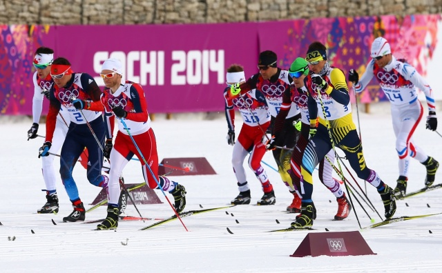 Martin Johnsrud Sundby (NOR), Alexander Legkov (RUS) and Alexey Poltoranin (KAZ) at the start of the men's skiathlon during the Sochi 2014 Olympic Winter Games. (Guy Rhodes-USA TODAY Sports)