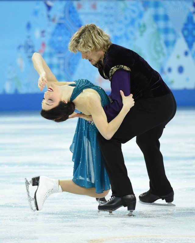 Meryl Davis and Charlie White of the USA perform in the team ice dance free dance during the Sochi 2014 Olympic Winter Games at Iceberg Skating Palace. Mandatory Credit: Robert Deutsch-USA TODAY Sports