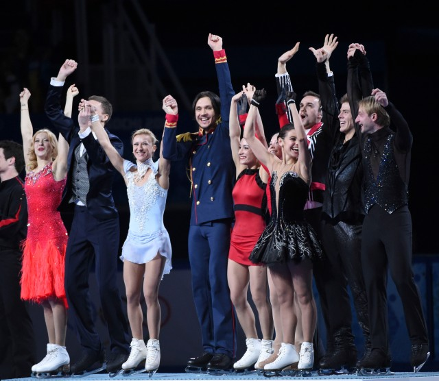 The Russian team figure skaters celebrate their victory during the Sochi 2014 Olympic Winter Games at Iceberg Skating Palace. Mandatory Credit: Robert Deutsch-USA TODAY Sports