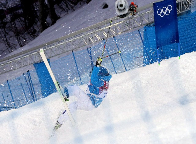Ville Miettunen (FIN) crashes during the freestyle skiing men's moguls qualification in the Sochi 2014 Olympic Winter Games at Rosa Khutor Extreme Park. Mandatory Credit: James Lang-USA TODAY Sports