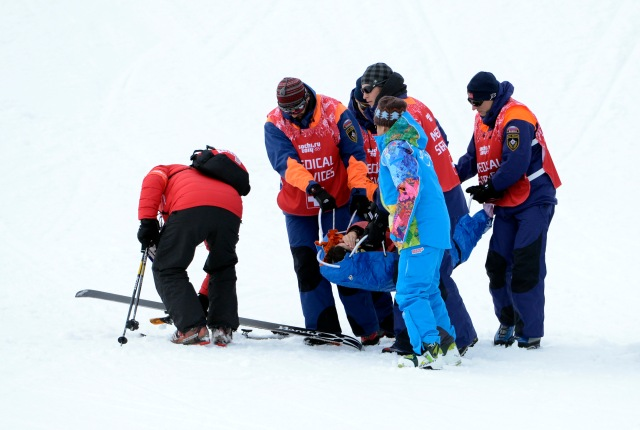 Yuki Tsubota (CAN) is helped off the course after a fall in the ladies' slopestyle finals during the Sochi 2014 Olympic Winter Games at Rosa Khutor Extreme Park. Mandatory Credit: Jack Gruber-USA TODAY Sports