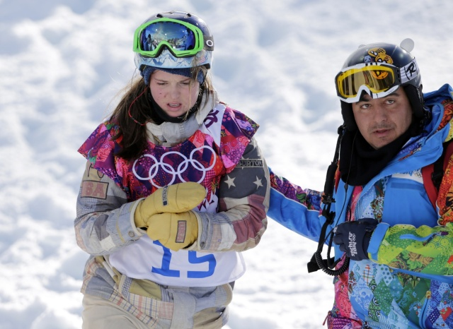 Arielle Gold is tended to after an apparent injury during practice for ladies' halfpipe qualification during the Sochi 2014 Olympic Winter Games at Rosa Khutor Extreme Park. (Andrew P. Scott - USA TODAY Sports)