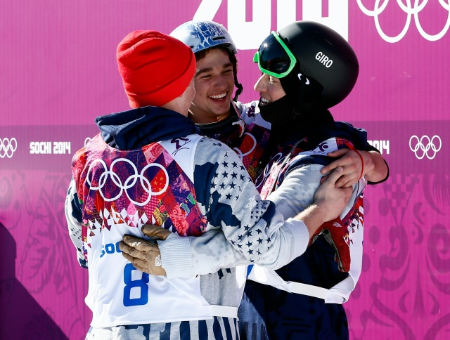 Joss Christensen (USA, right) celebrates winning gold with Gus Kenworthy (USA, left) who won silver and Nicholas Goepper (USA, center) who won bronze in the men's ski slopestyle final during the Sochi 2014 Olympic Winter Games at Rosa Khutor Extreme Park. (Rob Schumacher-USA TODAY Sports)