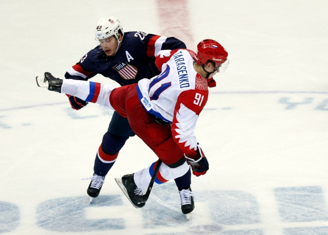 Russia forward Vladimir Tarasenko collides with USA forward Dustin Brown in overtime. (Winslow Townson-USA TODAY Sports)
