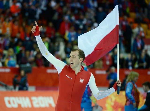 Zbigniew Brodka of Poland celebrates his gold medal in speed skating men's 1500m. (Robert Hanashiro-USA TODAY Sports)