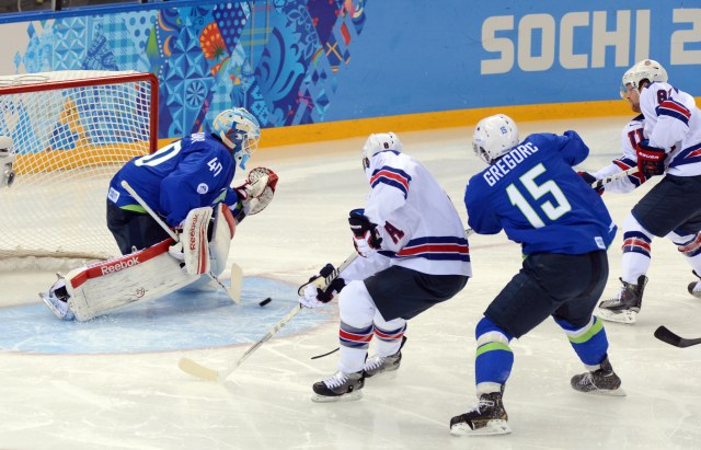 USA forward Phil Kessel (81) scores a goal past Slovenia goalie Luka Gracnar (40) in a men's ice hockey preliminary round game during the Sochi 2014 Olympic Winter Games at Shayba Arena. (Jayne Kamin-Oncea-USA TODAY Sports)