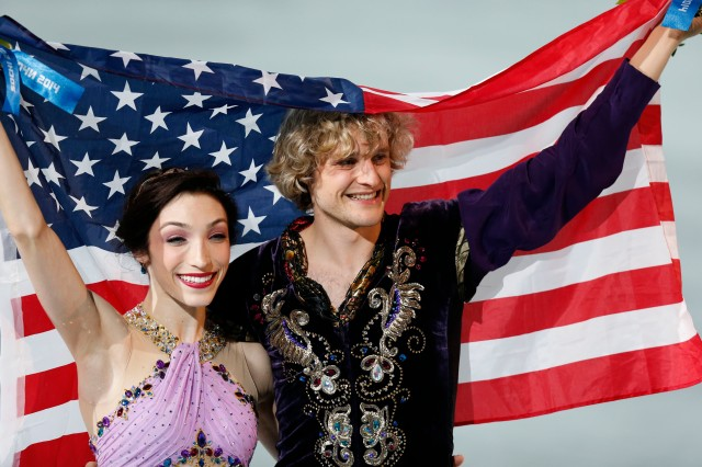 Charlie White and Meryl Davis (USA) celebrate winning the gold medal in ice dance free dance program during the Sochi 2014 Olympic Winter Games at Iceberg Skating Palace.  (Jeff Swinger-USA TODAY Sports)