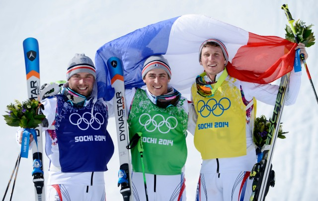 French skiers Arnaud Bovolenta (blue) and Jean Frederic Chapuis (green) and Jonathan Midol (yellow) celebrate on the podium after the final for men's ski cross during the Sochi 2014 Olympic Winter Games at Rosa Khutor Extreme Park. (Jack Gruber-USA TODAY Sports)