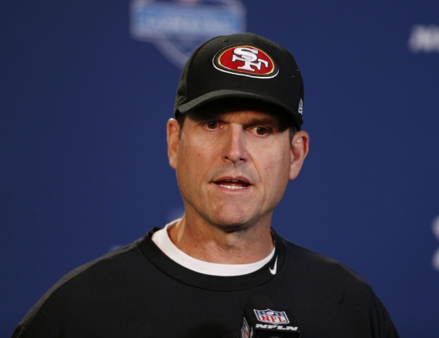 San Francisco 49ers coach Jim Harbaugh speaks during a press conference during the 2014 NFL Combine at Lucas Oil Stadium. (Brian Spurlock-USA TODAY Sports)