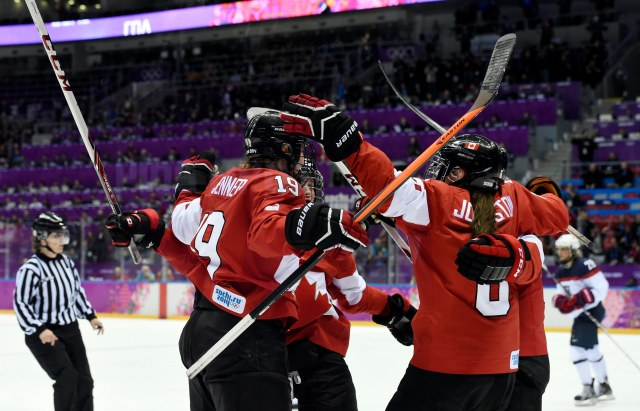 Canada forward Brianne Jenner (19) celebrates with teammates after scoring against USA in the third period. (Richard Mackson-USA TODAY Sports)