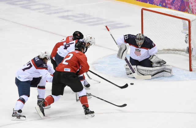 USA goalie Jonathan Quick (32) makes a save against Canada in the men's ice hockey semifinals during the Sochi 2014 Olympic Winter Games at Bolshoy Ice Dome. Richard Mackson-USA TODAY Sports.