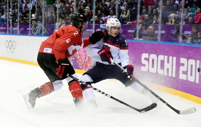USA forward Patrick Kane (88) battles for the puck with Canada defenseman Duncan Keith (2) in the men's ice hockey semifinals during the Sochi 2014 Olympic Winter Games at Bolshoy Ice Dome. (USA TODAY Sports)