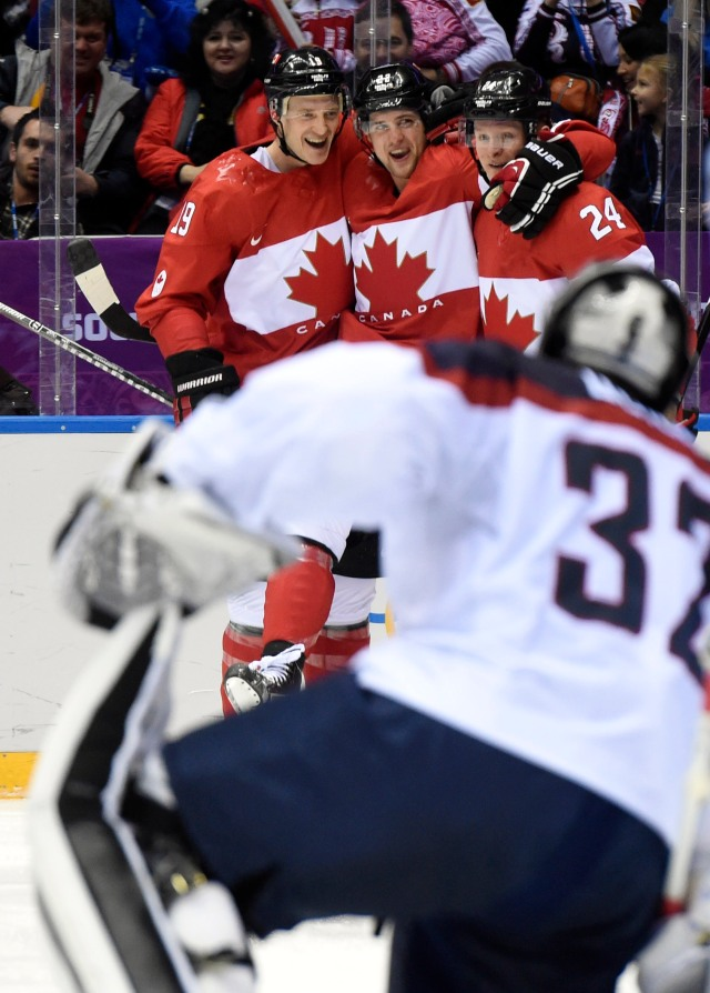 Canada forward Jamie Benn (22) celebrates with forward Corey Perry (24) and defenseman Jay Bouwmeester (19) after scoring a goal past USA goalie Jonathan Quick (32) in the second period in the men's ice hockey semifinals during the Sochi 2014 Olympic Winter Games at Bolshoy Ice Dome. Scott Rovak-USA TODAY Sports.