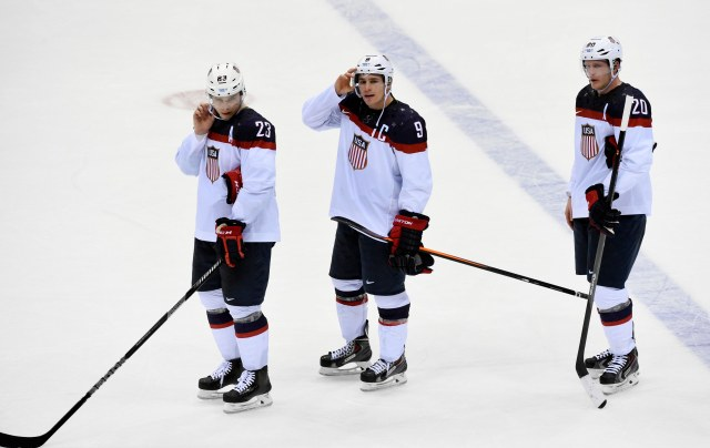 USA players Dustin Brown (23) , Zach Parise (9) and Ryan Suter (20) react after losing to Canada in the men's ice hockey semifinals during the Sochi 2014 Olympic Winter Games at Bolshoy Ice Dome. Richard Mackson-USA TODAY Sports.