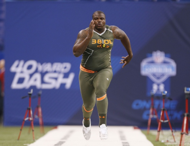 Auburn Tigers offensive lineman Greg Robinson runs the 40 yard dash during the 2014 NFL Combine at Lucas Oil Stadium. (Brian Spurlock - USA TODAY Sports)