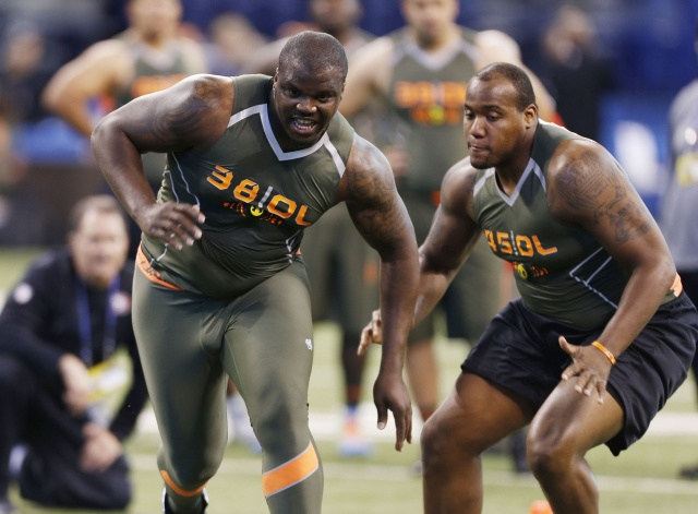 Auburn Tigers offensive lineman Greg Robinson participates in drills during the 2014 NFL Combine at Lucas Oil Stadium. (Brian Spurlock - USA TODAY Sports)