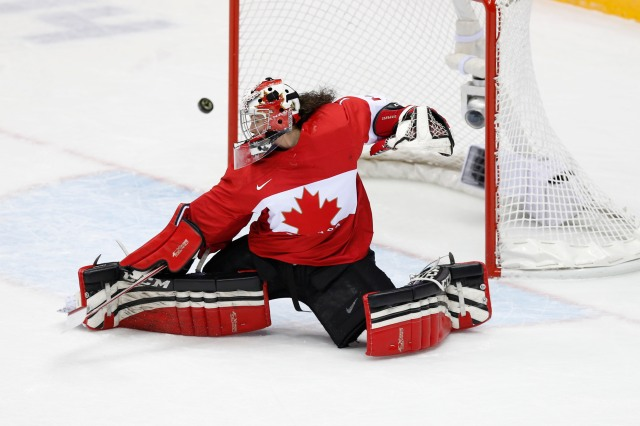Canada goalkeeper Shannon Szabados (1) makes a save against Brianna Decker. (Winslow Townson, USA TODAY Sports)