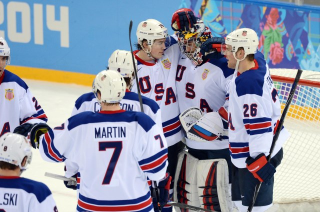 USA goalie Ryan Miller  is congratulated by teammates after defeating Slovenia in a men's ice hockey preliminary round game during the Sochi 2014 Olympic Winter Games at Shayba Arena. (Jayne Kamin-Oncea, USA TODAY Sports)