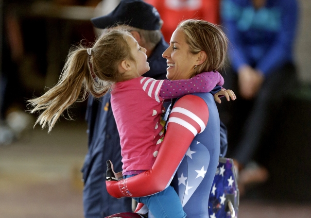 Noelle Pikus-Pace receives a hug from her daughter Lacee.   (AP Photo/Rick Bowmer)