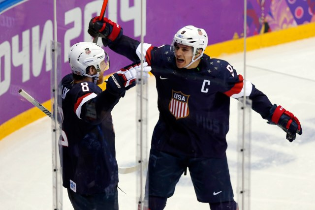 USA forward Joe Pavelski (8) celebrates with forward Zach Parise (9) after scoring a goal against Russia.(Winslow Townson, USA TODAY Sports)