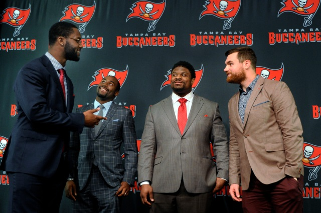 The Tampa Bay Buccaneers introduce four players new to the team; from left are  Michael Johnson, Alterraun Verner, Clinton McDonald and Brandon Myers. (AP Photo/The Tampa Tribune, Jay Conner)