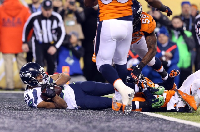 Seattle wide receiver Doug Baldwin scores a touchdown against the Broncos in Super Bowl XLVIII. Baldwin will be a restricted free agent.  (Matthew Emmons, USA TODAY Sports)